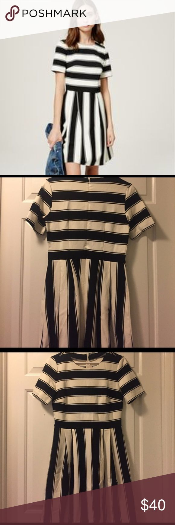 LOFT Fit and Flare Black and White Striped Dress Black and white striped fit and flare dress from LOFT with crew neck, short sleeves, and back zipper. Skirt is pleated. Super comfortable and flattering on all body types with a good amount of stretch.  - 68% rayon, 27% nylon, 5% spandex - Machine washable, dry flat - Size 6  Used but in great condition with no major flaws and no major stains. Only worn a handful of times. Well-taken care of. LOFT Dresses Mini