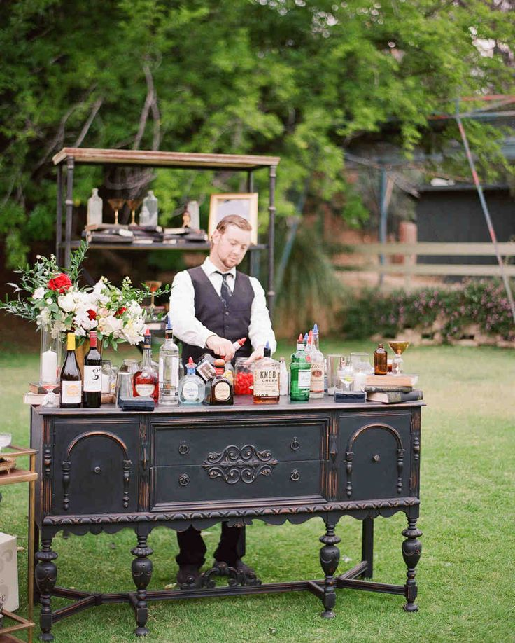 "A Whimsical Malibu Wedding Inspired by the Greatest Love Stories | Martha Stewart Weddings - A makeshift cocktail bar featured a vintage dresser and a bookshelf complete with glass bottles, framed pictures and other knick-knacks, doubled as the location's watering hole. The set-up also included a fun, tongue-in-cheek sign that displayed the words, ""Prohibition Ends Here."""