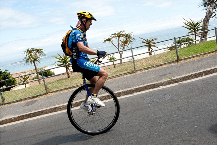 A male cyclists endures the challenging 109km race on a unicycle!