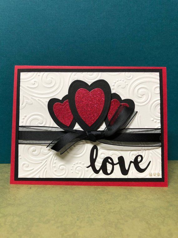 Valentine Card Hearts Red Glitter And Black Hearts With Love