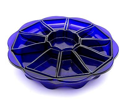Cobolt-blue pressed glass hors d'oeuvre set on turning table 10-sided with nine triangle bowls one bowl is missing and one ten-sided bowl in the middle design K.P.C.de Bazel 1919 executed by Glasfabriek Leerdam / the Netherlands