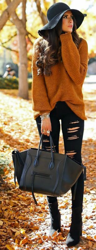 Emily Ann Gemma + couldn't look more cosy + autumnal knitted sweater + distressed black jeans + wide brimmed black hat + elegant style + individual edge.   Sweater: Free People, Jeans: AG, Boots: BCBG.