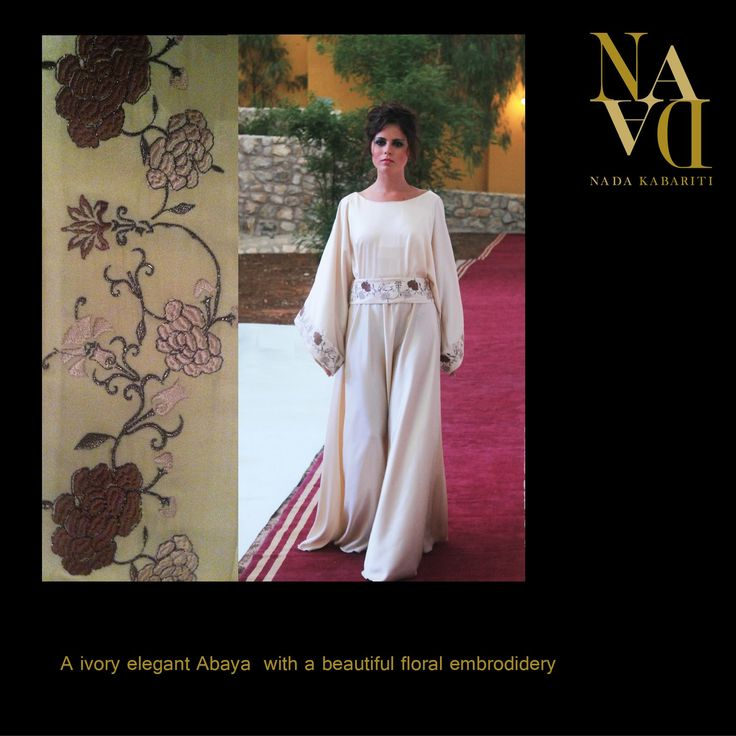 An ivory elegant abaya with beautiful floral embroidery designed by Nada Kabariti