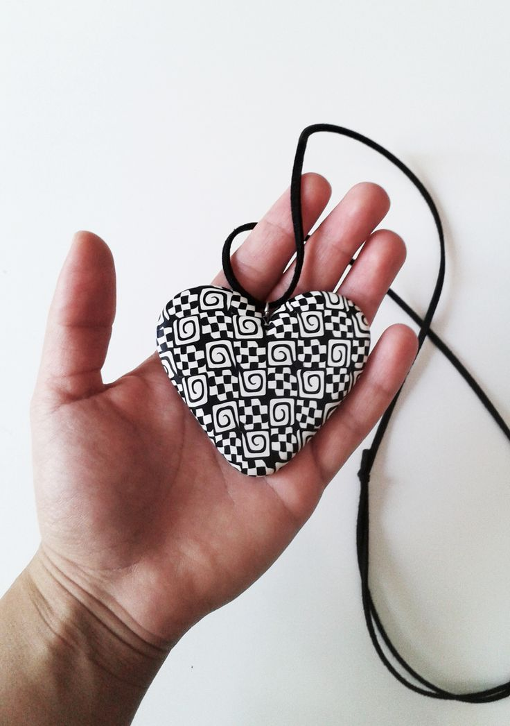 handmade polymer clay heart pendant decorated with black & white patterns