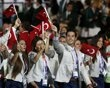 Members of Turkey's contingent wave flags during the opening ceremony of the London 2012 Olympic Games at the Olympic Stadium