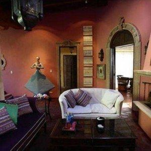 Mexican Style Living Room With Fireplace And Decorative Fabric And Wall Art , Lively Mexican Style Living Room In Living Room Category