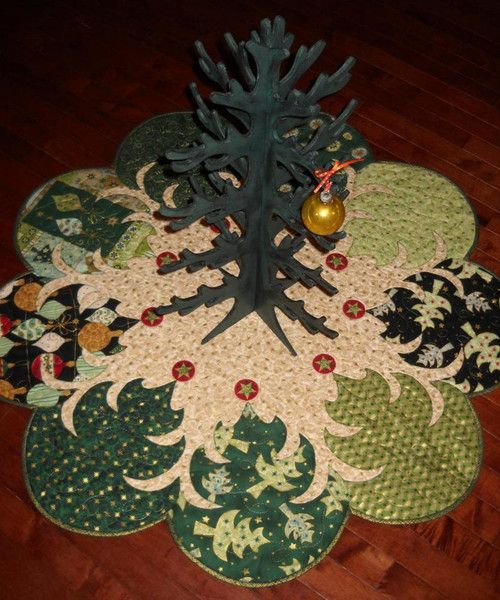 "40"" Diameter ~ Pattern for this beautiful tree skirt or table topper. Directions included for raw edge machine applique as you quilt, bias binding and the paper templates to create these lovely trees"