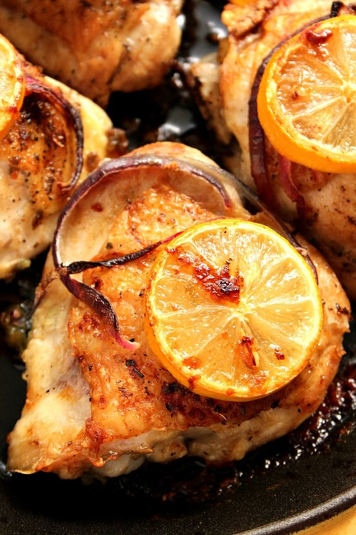 Lemon Garlic Roasted Chicken recipe - mouth-watering chicken thighs roasted with garlic and lemons. Ridiculously easy to make and pure comfort food.