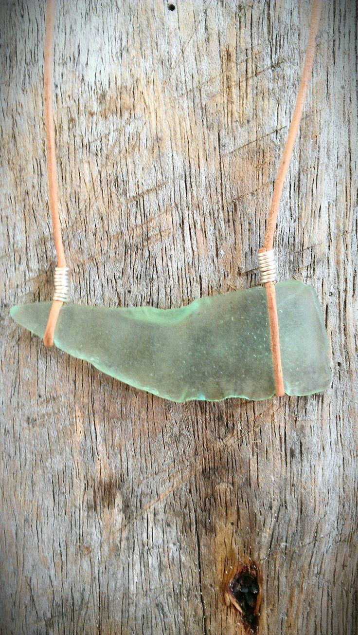 Pale Sea Foam Green Sea Glass on Natural Leather Necklace. $10.00, via Etsy.