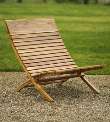 The Valencia Teak Chair ($330) from VivaTerra mimics the shape of Mies van der Rohe's Barcelona Chair, and is made from sustainably grown Laotian teak.