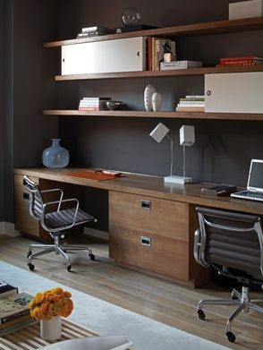 Fantastic office space! Eames black aluminum office chairs, wood file cabinets and countertop desk area, brown wood floating shelves and gray black walls paint color. brown black office colors. Source: S. Russell Groves
