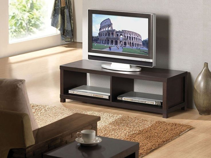 "Carmeno Espresso TV stand 91115 for $256 Features : Carmeno Collection   Espresso Finish With 2 shelves Dimensions : TV Stand : 43"" x 15"" x 14""H"