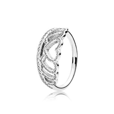 This extravagant tiara ring features a pretty filigree heart pattern, embellished with sparkling stones. Worn alone or with other stackable bands for a textured look, it is a classic and elegant piece for day or evening events alike. #PANDORA #PANDORAring