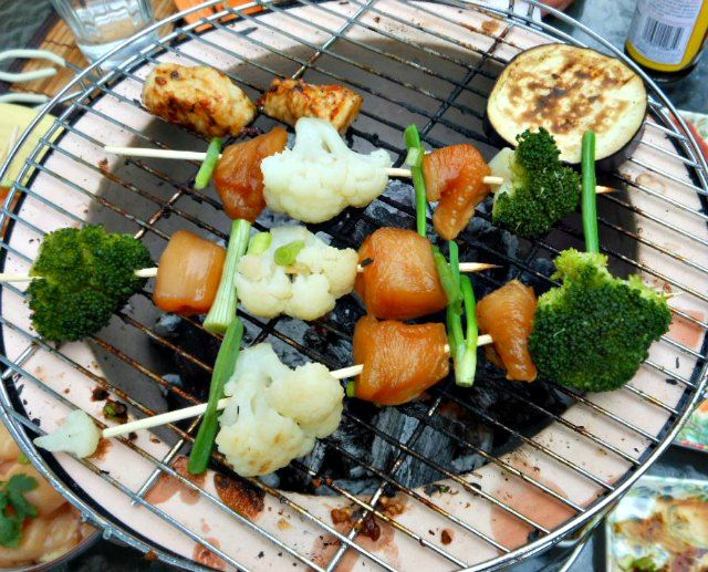 Yakitori On The Konro, Japanese Ceramic Grill Heated With Charcoal