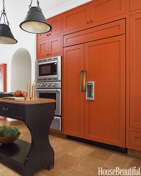 A bold burnt orange kitchen orange kitchen burnt for Burnt orange kitchen cabinets