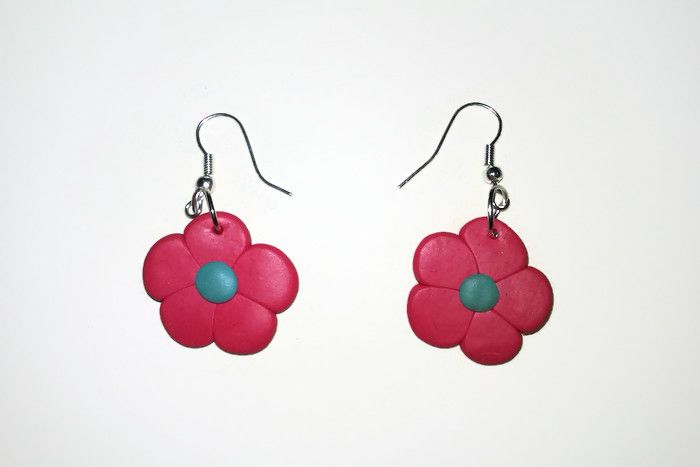 As typically girly as it gets, pink flower earrings.  www.facebook.com/thequirkycrafthouse