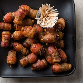 Devils on Horseback Appetizers, by Cook's Country. -- This retro appetizer gives an intense performance at cocktail hour: smoky, crispy bacon wrapped around sweet dates filled with tangy blue cheese.