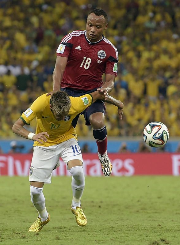 Brazil's Neymar is fouled by Colombia's Juan Zuniga during the World Cup quarterfinal soccer match between Brazil and Colombia at the Arena ...