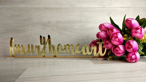 Check out this item in my Etsy shop https://www.etsy.com/listing/514362512/custom-name-wedding-sign-wedding-decor
