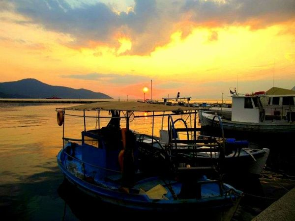 Limenas port at sunset time