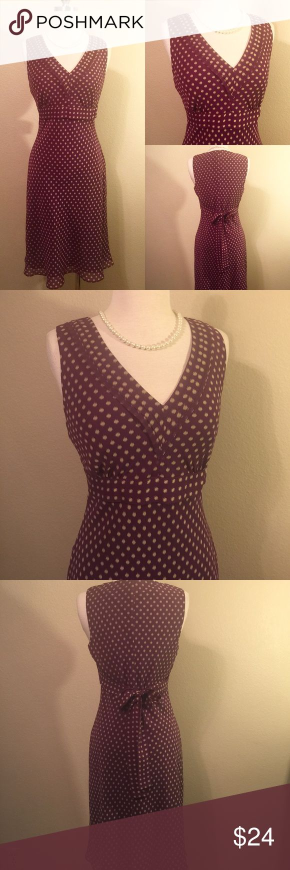 Ann Taylor Dress Ann Taylor Petites Dress Size: 8P  B:18'  W:15.5' H:18' L:39'  Beautiful burgundy Ann Taylor petites dress.  Sleeveless with long ties that tie back to adjust to your waistline.  Side zipper. Has an old classy vintage look to it. Like new without tags. Flawless. Ann Taylor Dresses Midi