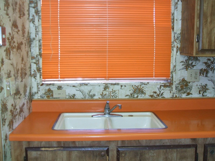 I also cleaned a few ancient mobile homes. One of them had these orange blinds and kitchen counters, plus orange shag carpeting in the bedroom!