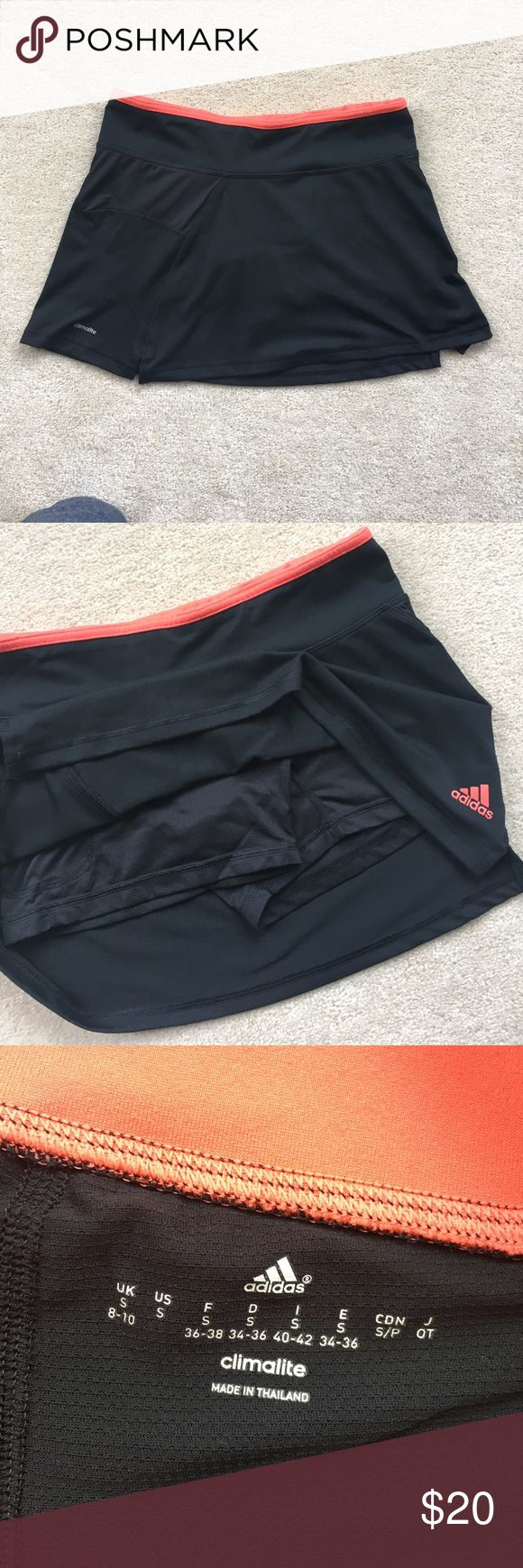 Adidas Coral/Black tennis skirt (shorts lining) Adidas tennis skirt. Worn once. Great condition. Cute black skirt with coral colored linen bag and trim. adidas Skirts