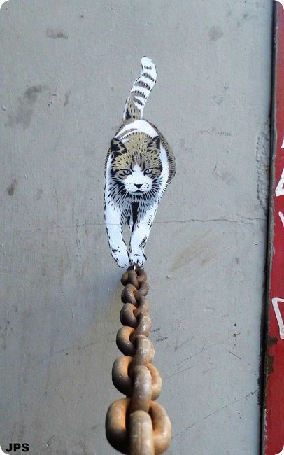 cat walking on chain street art