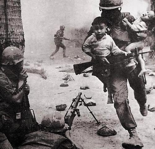 A soldier rescuing Vietnamese children