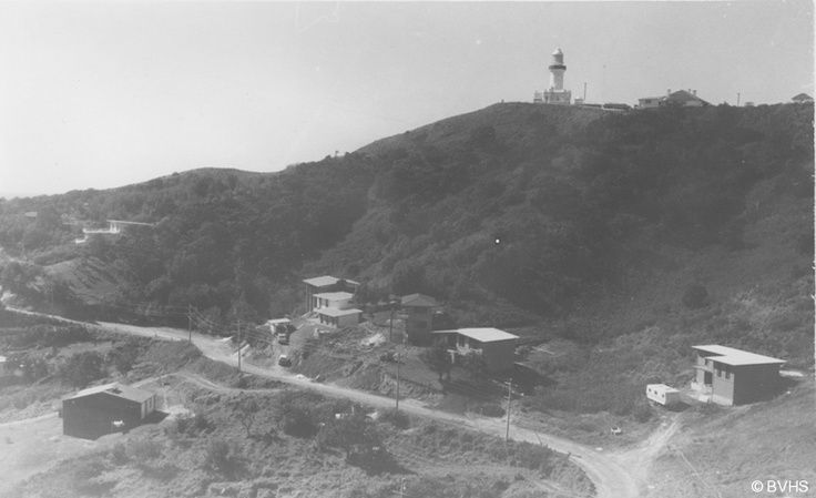 Wategos Beach, nested under the Cape Byron Lighthouse circa unknown