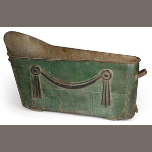 A Directoire cast and green-painted metal bathing tub late 18th/early 19th century greatest height 30in (76cm); length 54 1/4in (137.5cm); width 21in (53.5cm) Estimate: US$ 2,000 - 3,000 £1,300 - 2,000 €1,500 - 2,300 Bath