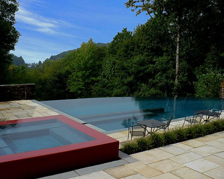 Infinity pool with raised red spa and hilltop view by Group Works, LLC, Wilton, CT http://www.luxurypools.com/swimmingpoolbuilder/Group-Works-LLC?fid=86 Photography by Lee Anne White