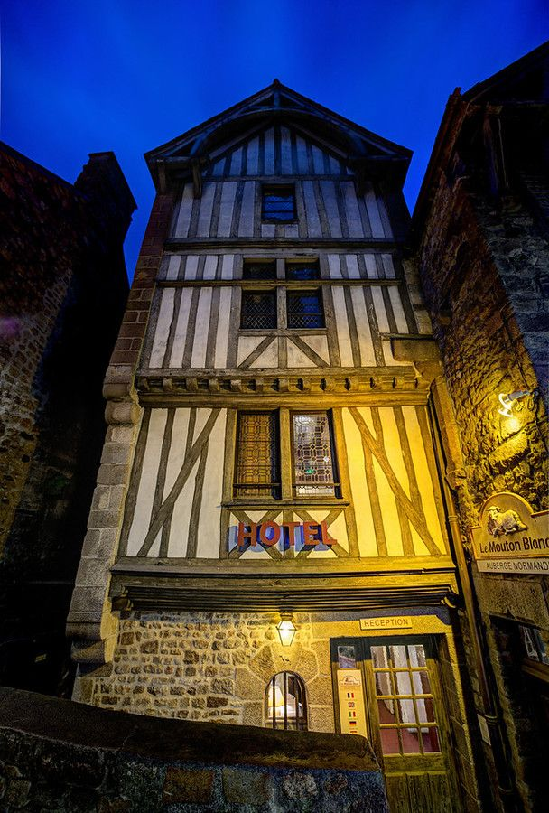 I'm sure Europeans find this kind of architecture to be quaint and banal, but I rather like it. In fact, I'd say it's just about one of my favorites! Whenever I see old buildings in this style, it makes me a little bit happy. - Mont Saint Michel, France - Photo from #treyratcliff Trey Ratcliff at http://www.StuckInCustoms.com