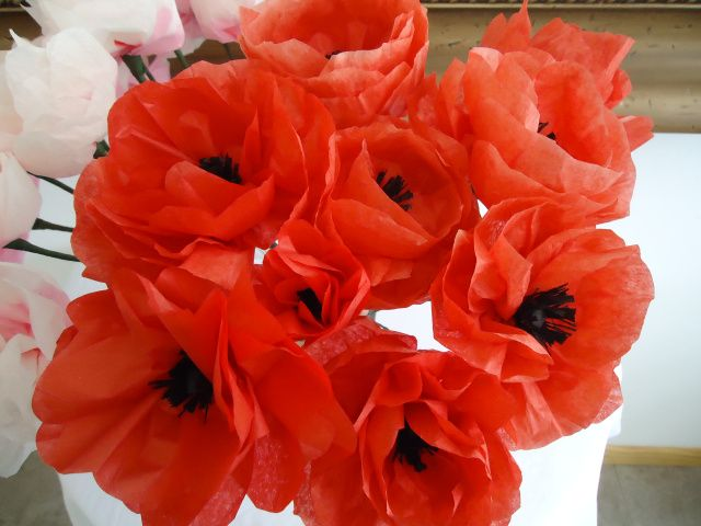 Tissue paper poppies made using Martha Stewart instructions for poppy center with peony petals. Perfect!