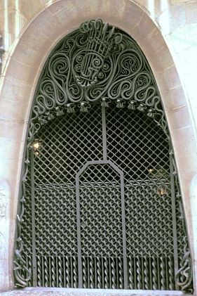 Gated entry at the townhouse of the industrialist Eusebi Güell, by architect Antoni Gaudi.  The entrance is large enough to accommodate carriages and leads to the stables.  by Mary Ann Sullivan