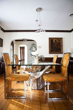 funky patterned orange chairs silver tree sequoia dining table with a glass top cluster glass pendant light