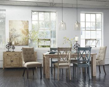 A modern twist on vintage casual and a fun way to mix dining chairs. Love the chunky rustic dining table!