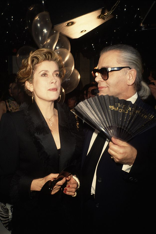 Catherine Deneuve and Karl Lagerfeld at the Fashion Week party in Bains  Douches, ca.1990. 80c4211a9a95