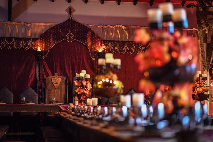 Amber and red Medieval setup. Thrones, candlesticks, Pumpkins.