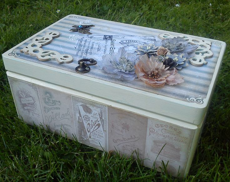 7. largest wooden box, decorated with scrapbook paper, acrylic paints, fabric and metal ornaments