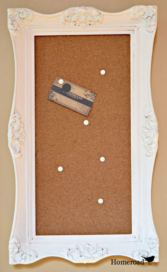 white vintage framed cork board