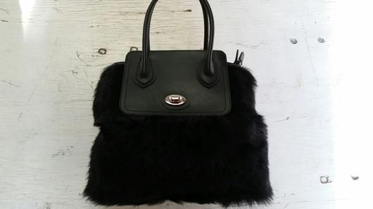 Tuscana Lamb and Leather Handbag  Check out our handbags here: http://www.shopsydneygittermanfurs.ca/collections/handbags/products/tuscana-lamb-and-leather-handbag