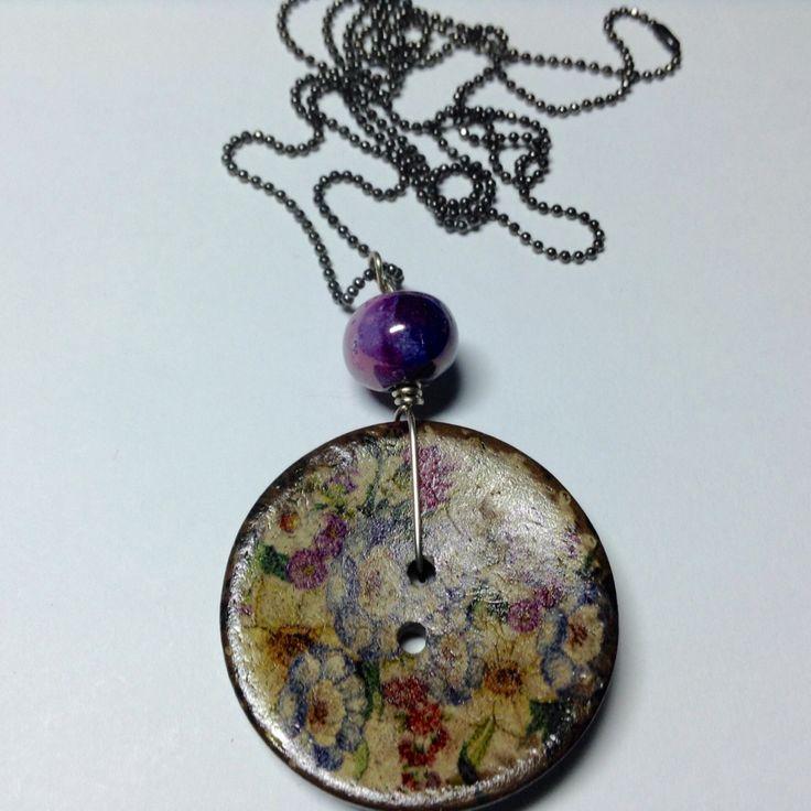 https://www.facebook.com/TheodoraCheiropoietoKosmema/ Pendant with button and ceramic beads