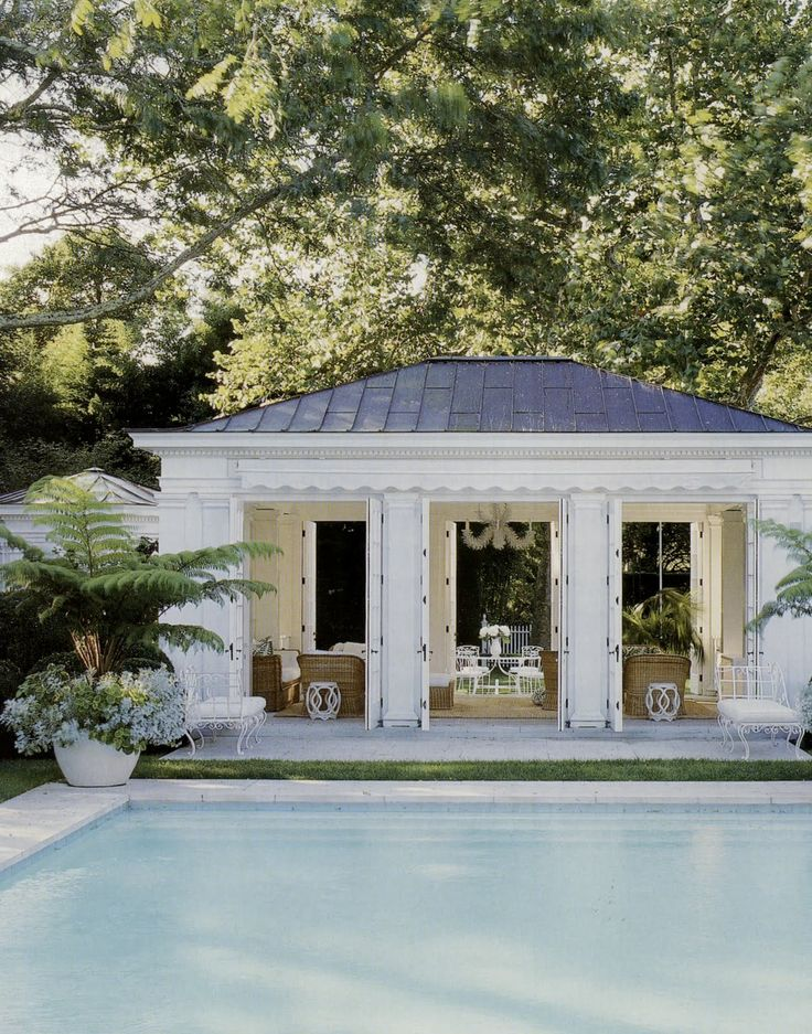 Poolhouse. I love how the house is the width of the pool and so people can just step right outside!  Beautiful!