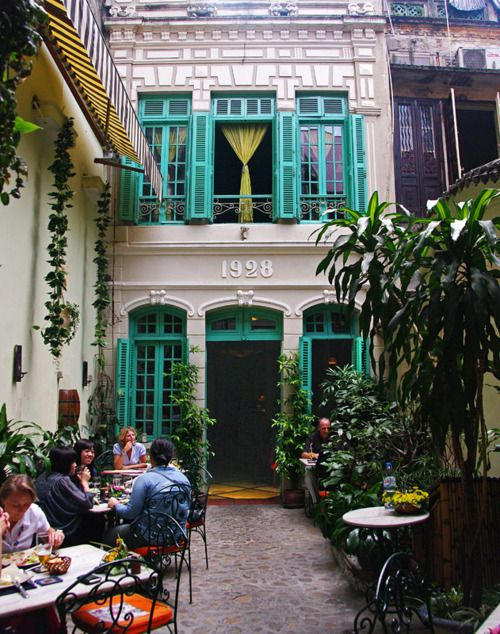 courtyard, turquoise shutters