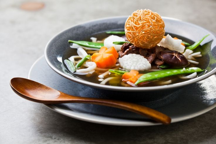 Beef Ramen soup with grilled beef fillet, daikon, shitake mushrooms, carrot and udon noodles