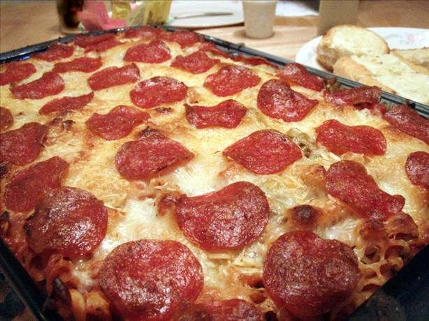 Pizza Casserole-Says serves eight but it will definitely serve more! I split it into two eight by eight pans, and each one was more than enough to feed our family of six!