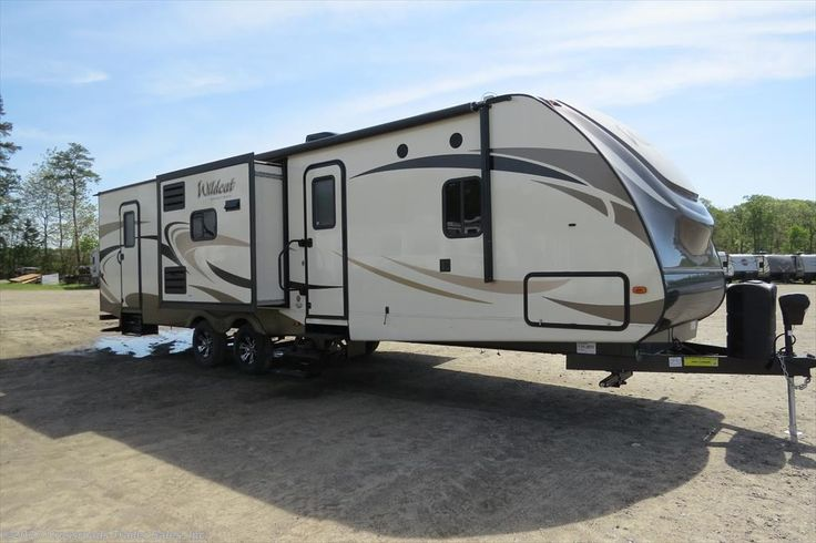 This New 2017 Forest River Wildcat 322TBI has a brand-new bunkhouse travel trailer floorplan with sway command tow control system! Sleeps 7 with bunkbeds, Queen bed in master bedroom, sleeper sofa, and more. Travel in style and comfort! Save over $11,000 today! For more information click here: http://www.crossroadstrailers.com/2017-forest-river-wildcat-322tbi-new-travel-trailer-nj-i1902775