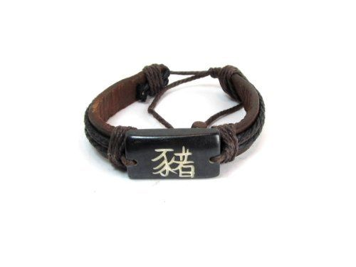 Year of the Pig Chinese Zodiac Tribal Leather Bracelet Creative Ventures Jewelry. $8.99. Leather bracelet with wrap around cord. The Pig person is known for their Braveness and Loyality. Year of the Pig Kanji symbol. Adjustable with slip knot at the back of the bracelet