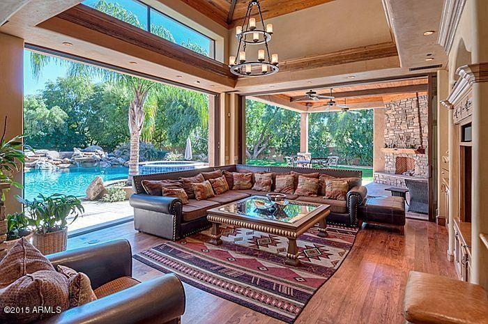 Southwestern Living Room with Nanawall - folding/sliding glass walls, High ceiling, Carpet, Bernhardt Brae Sectional Sofa
